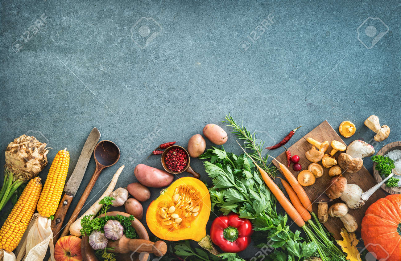Healthy or vegetarian nutrition concept with selection of organic autumn fruits and vegetables on rustic wooden table - 106299597