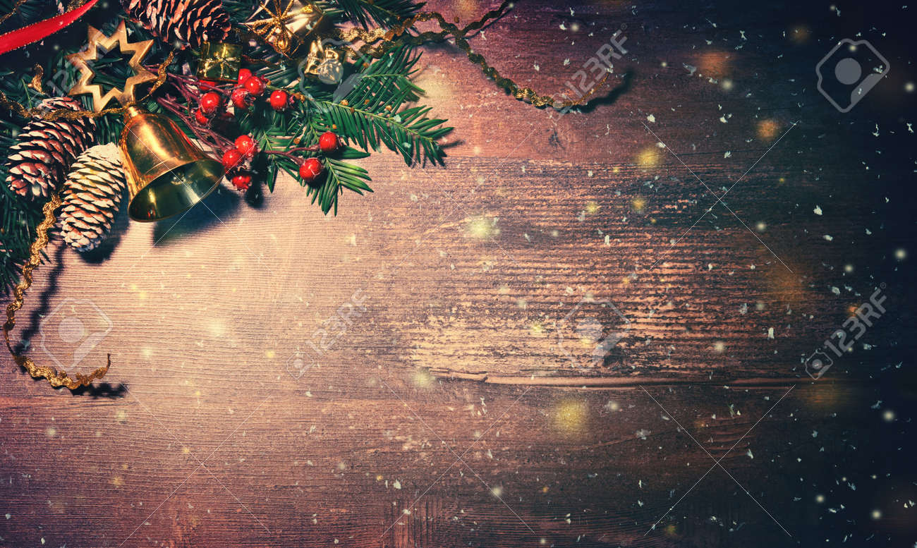 Christmas background with fir tree and decoration on dark wooden board - 111448517