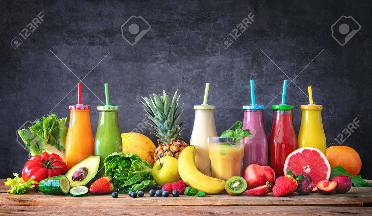 Colorful freshly squeezed fruits and vegetables smoothies with ingredients for healthy eating. Detox, dieting or healthy food concept - 117666716