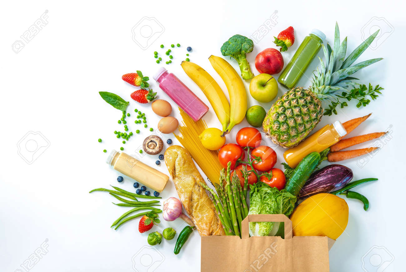 Healthy food selection. Shopping bag full of fresh vegetables and fruits isolated on white - 117666776