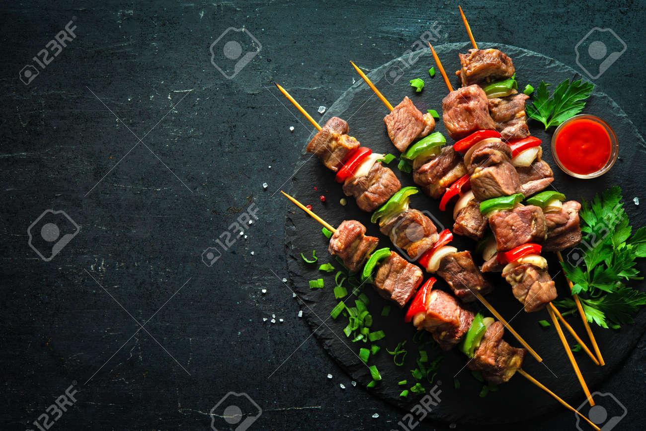 Kebabs - grilled meat and vegetables on skewers - 120788032