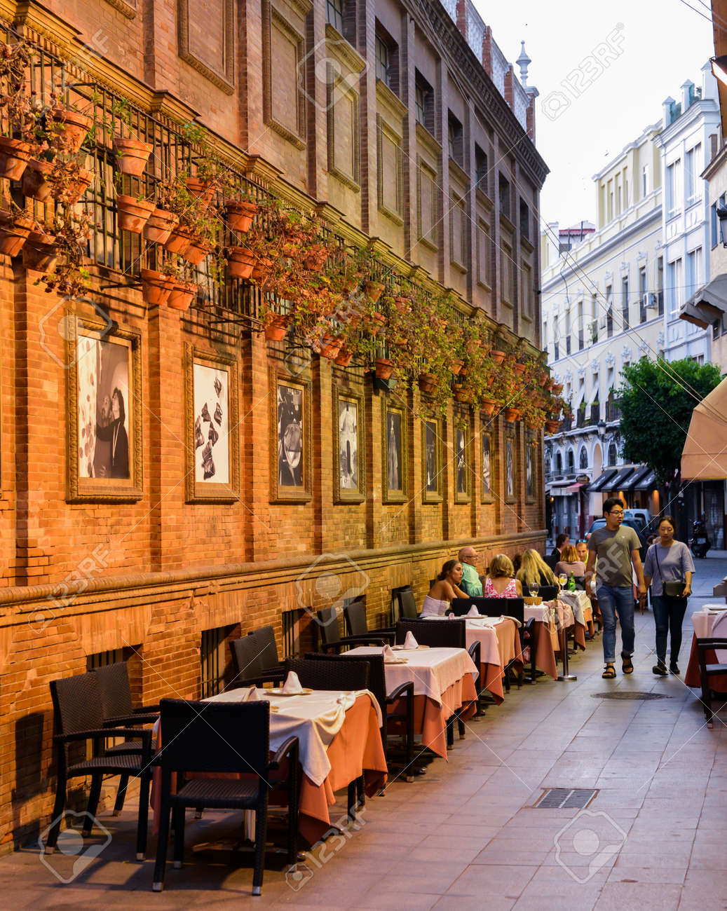 Romantic outdoors Spanish restaurant with flower pots on wall in the heart of the old city & Romantic Outdoors Spanish Restaurant With Flower Pots On Wall ...