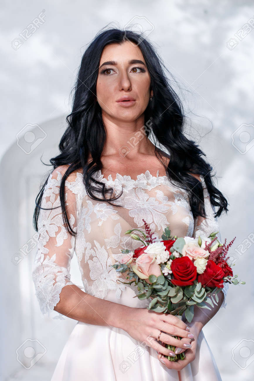 Beautiful Young Bride With Long Dark Hair And A Long White Wedding