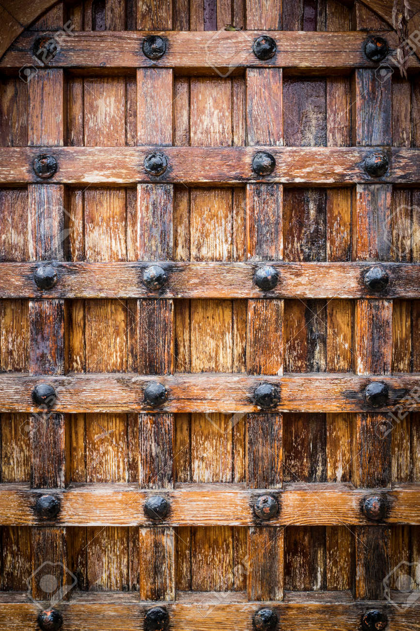 Oldcastle doors stone door of old castle oldcastle doors carved rustic door rustic house old castle door texture with faded wood stock photo eventelaan Image collections