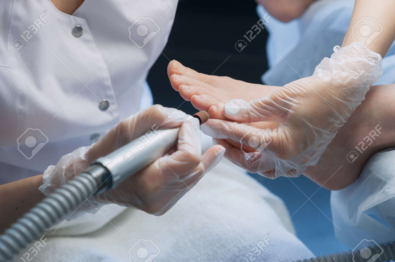 A Professional Technician Grinding Machine, Nail Polish ...