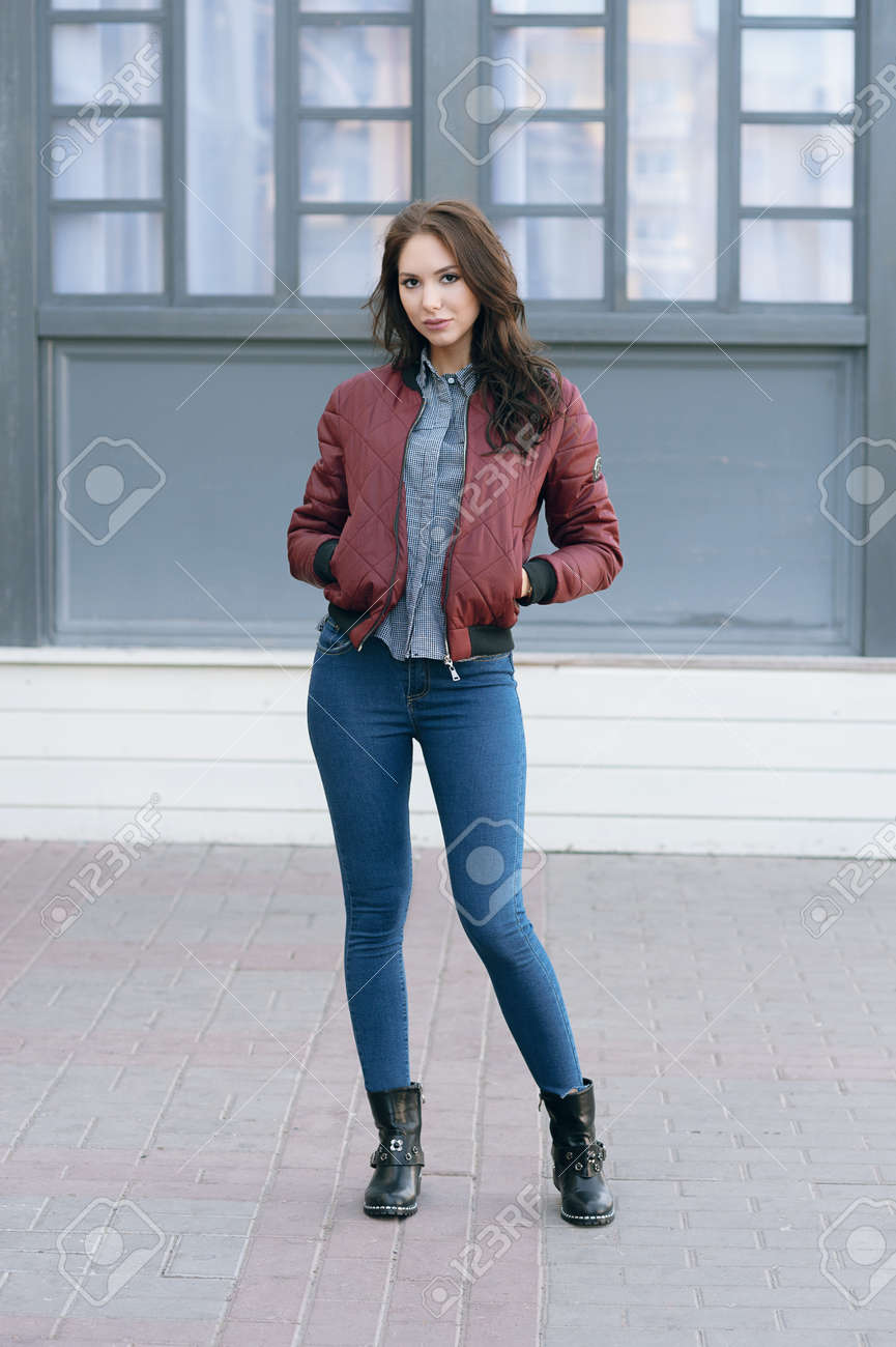 2e9a3bb63 Young beautiful stylish woman in a burgundy pilot's jacket and..