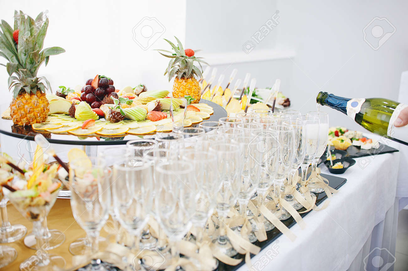 A Beautiful Fruit Bar Serving A Festive Table The Waiter Pours