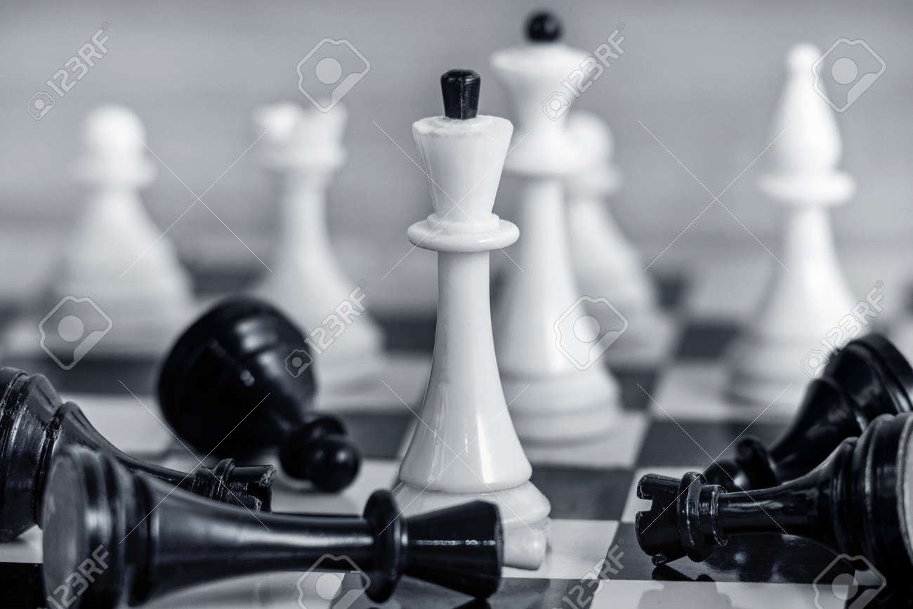 The concept of team success and corporate spirit. White chess pieces on the chessboard Around them lie the defeated black pieces. - 143958729