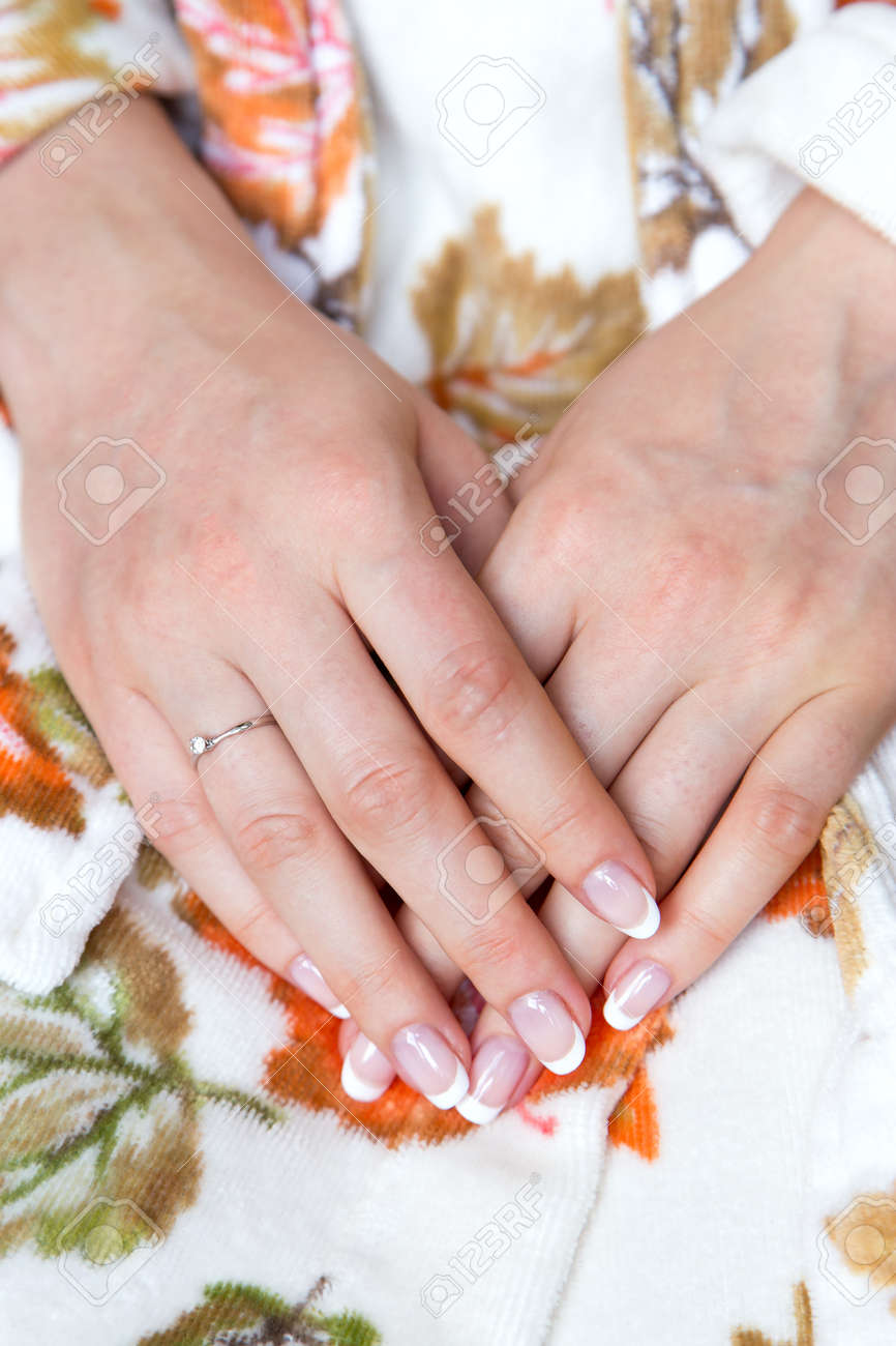 French Manicure. Wedding Ring On The Finger Stock Photo, Picture And ...