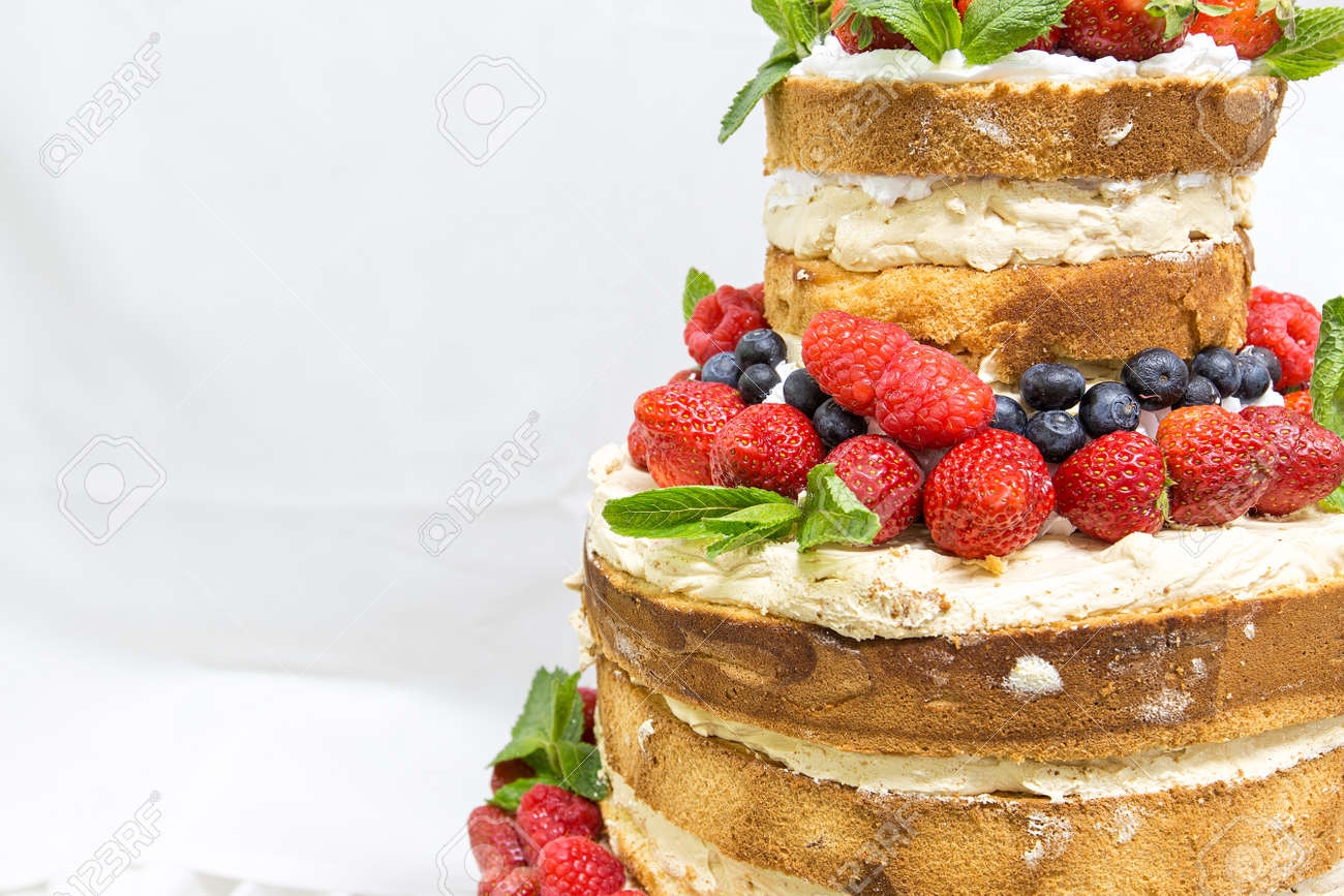 Wedding Cake With Open Biscuit Shortcakes Cream And Fruit