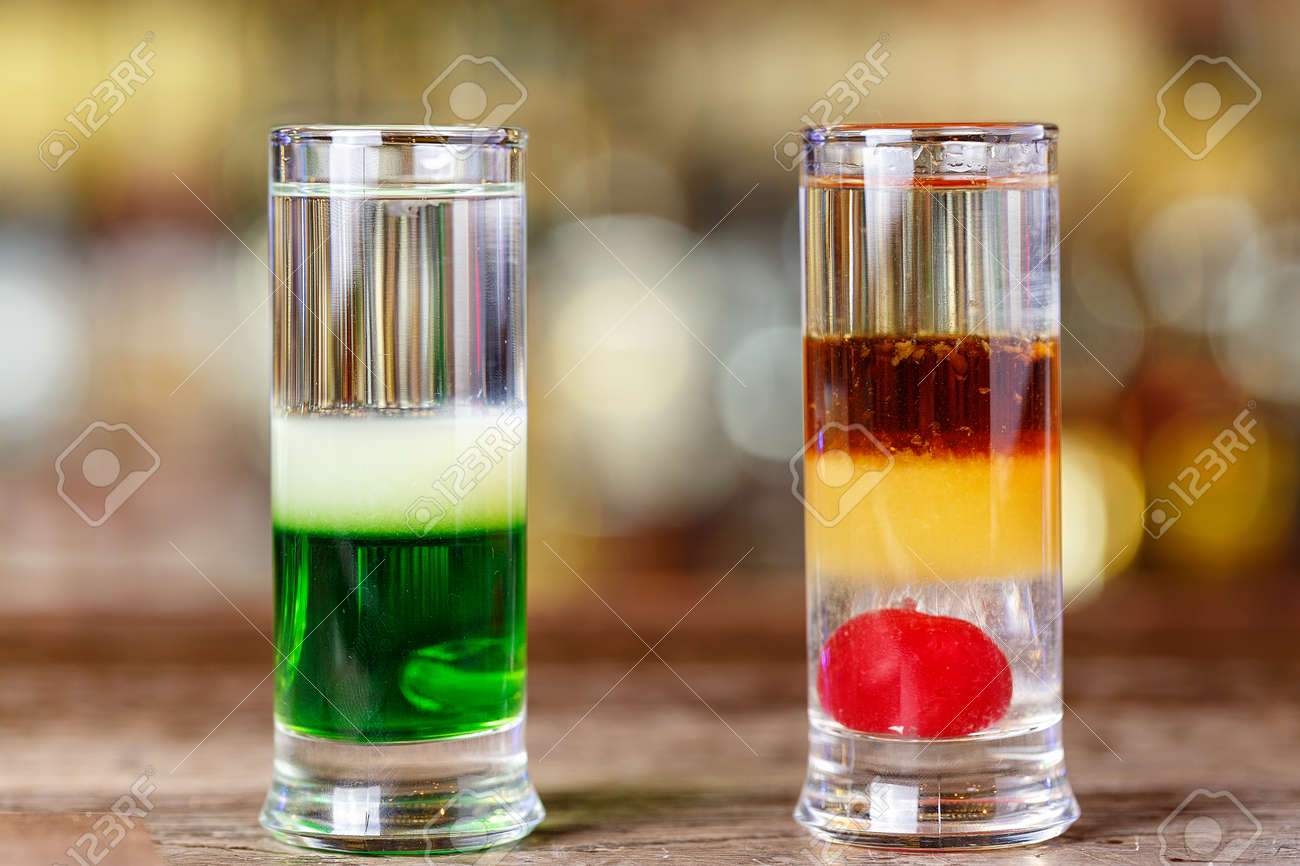 Multi-colored cocktail set stand on the bar in the nightclub