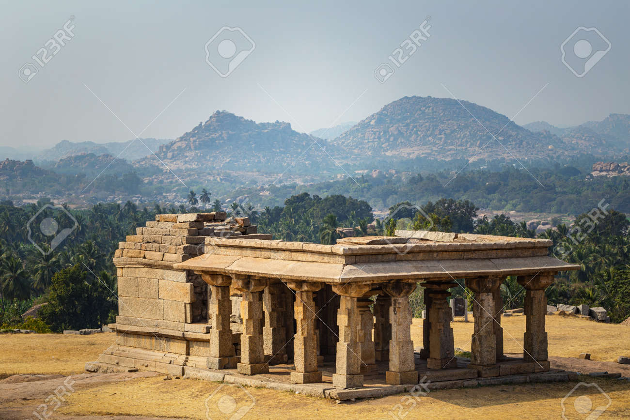 Beautiful view of the amazing Hampi's ruins. Hampi, also referred to as the Group of Monuments at Hampi, located in east-central Karnataka, India. - 135892169