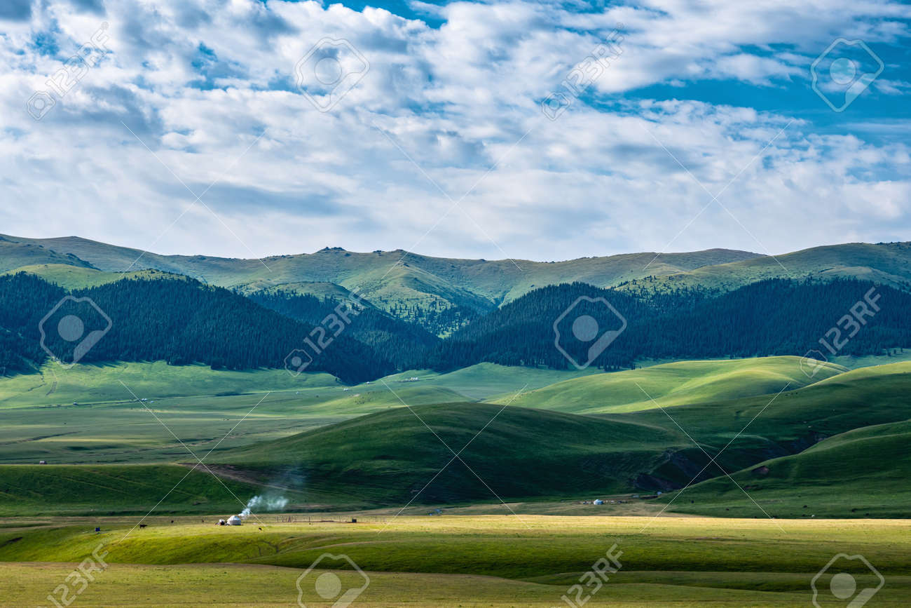A magnificent landscape of traditional pastures of the nomadic peoples of Asia. Yurt in the pasture. Assy plateau. Kazakhstan - 155798911