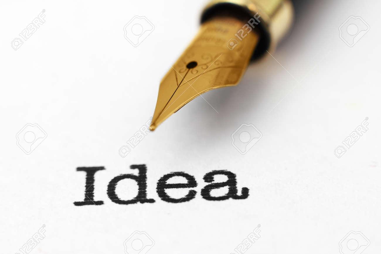 Fountain pen on idea text Stock Photo - 24308747