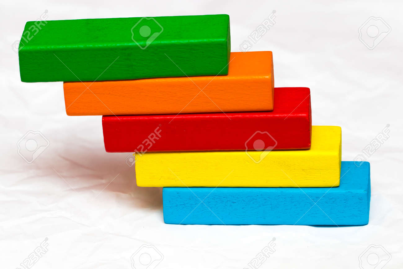 Stock Photo   Toys Blocks Step Stair, Building Bricks Over White Color  Background.