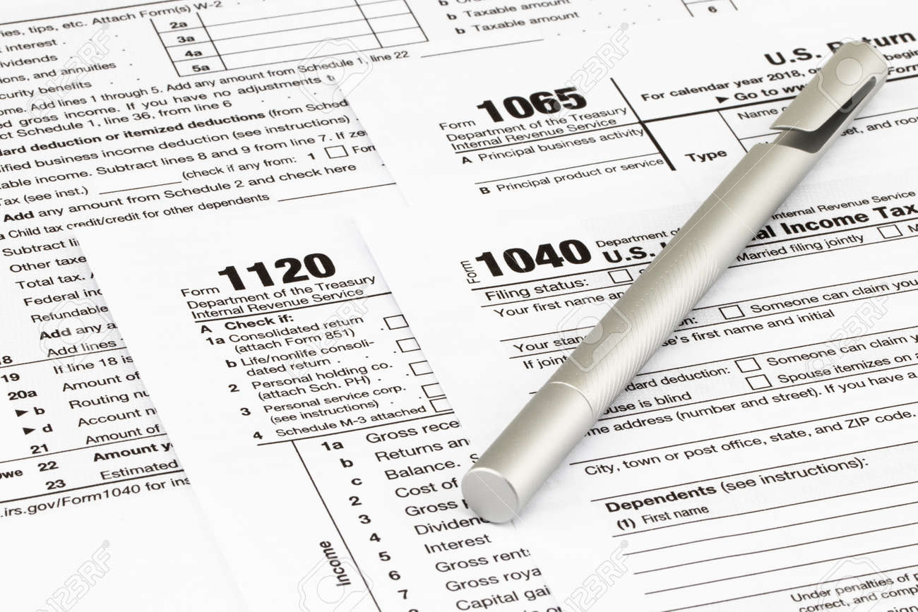 The tax forms with money and the pen. Tax Day concept. - 114199857
