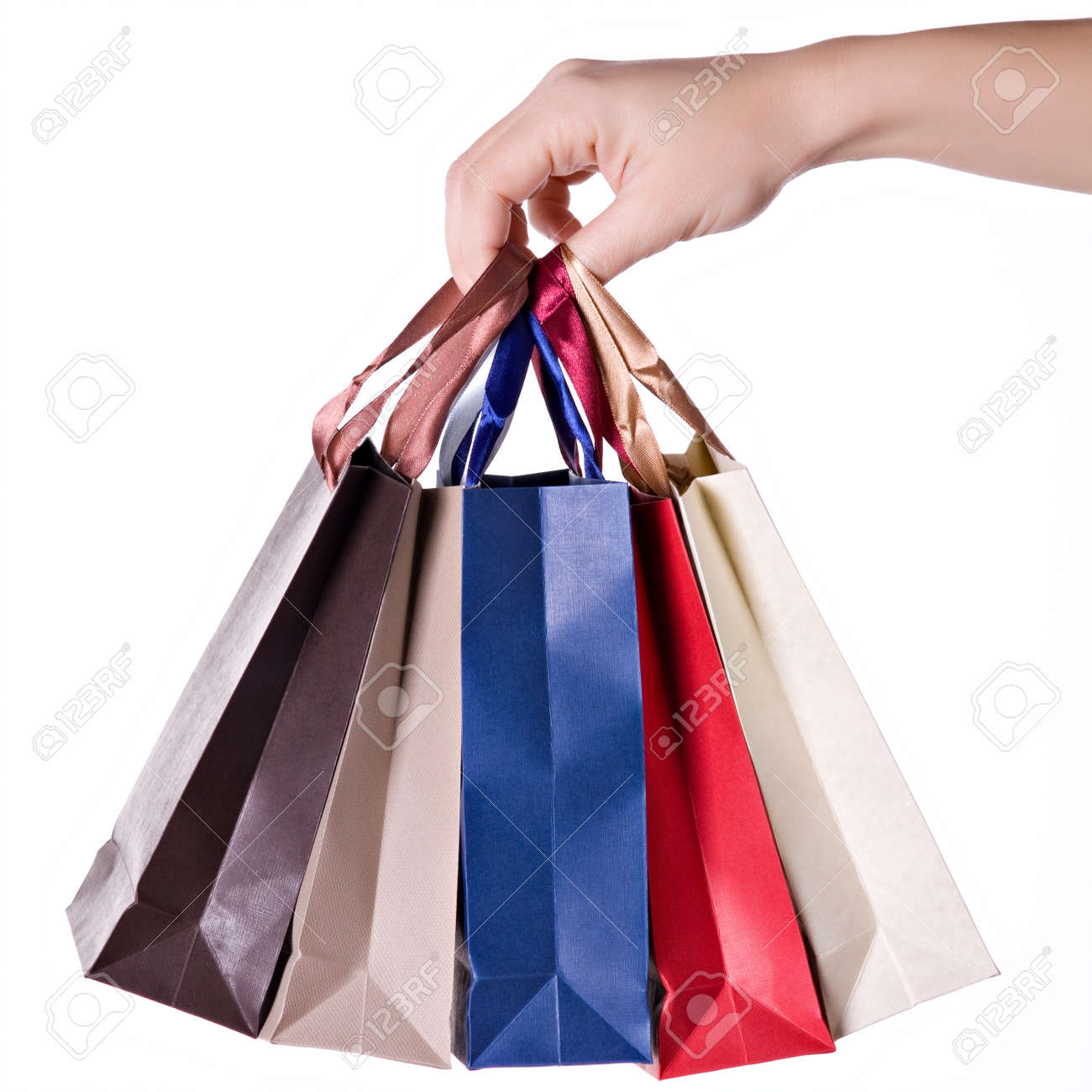 Woman Hand Carrying A Bunch Of Shopping Bags Isolated On White Stock Photo Picture And Royalty Free Image Image 11464812