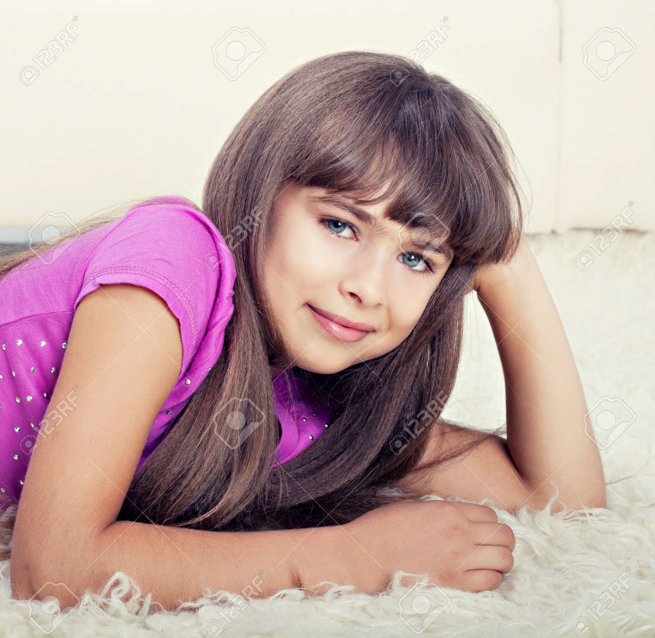 Beautiful girl lying on floor Stock Photo - 14866564