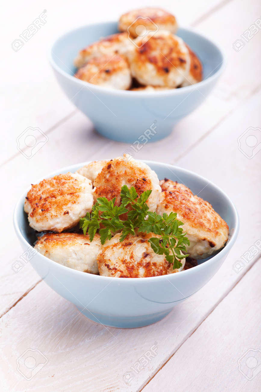 Meatballs in blue bowls on table with fresh parsley Stock Photo - 21744370