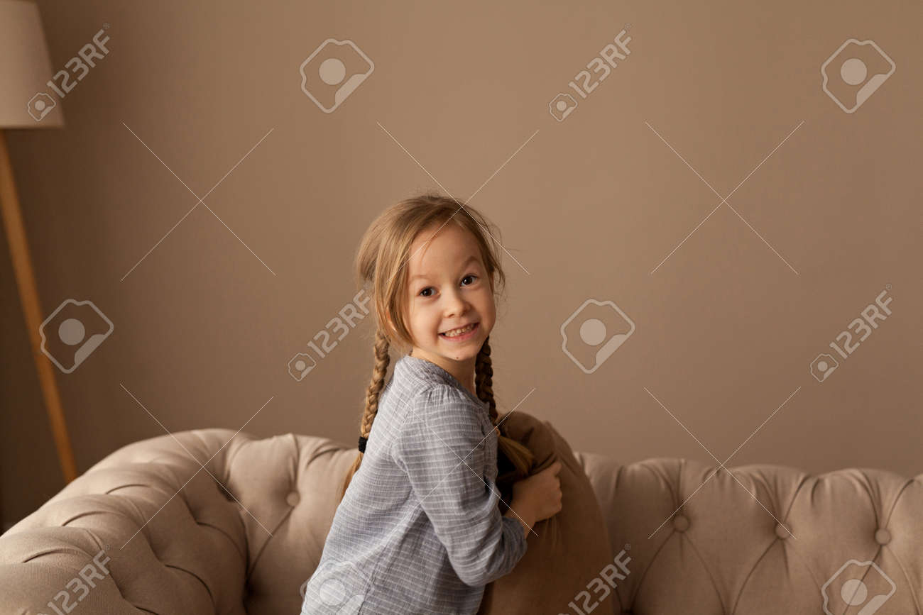 Seven year old girl plays pillow fight - 130267930