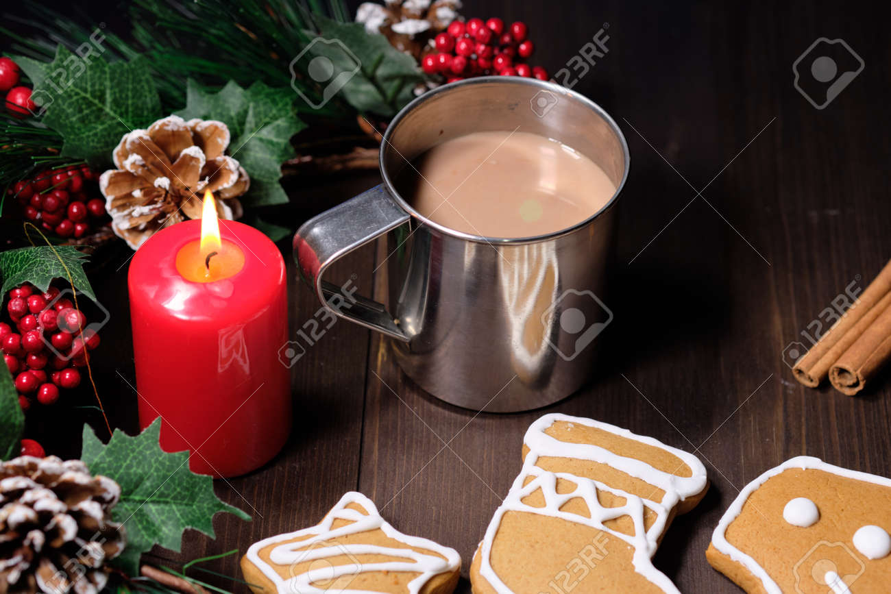 Almond Cookies And Coffee With Milk In The Iron Cup On Brown