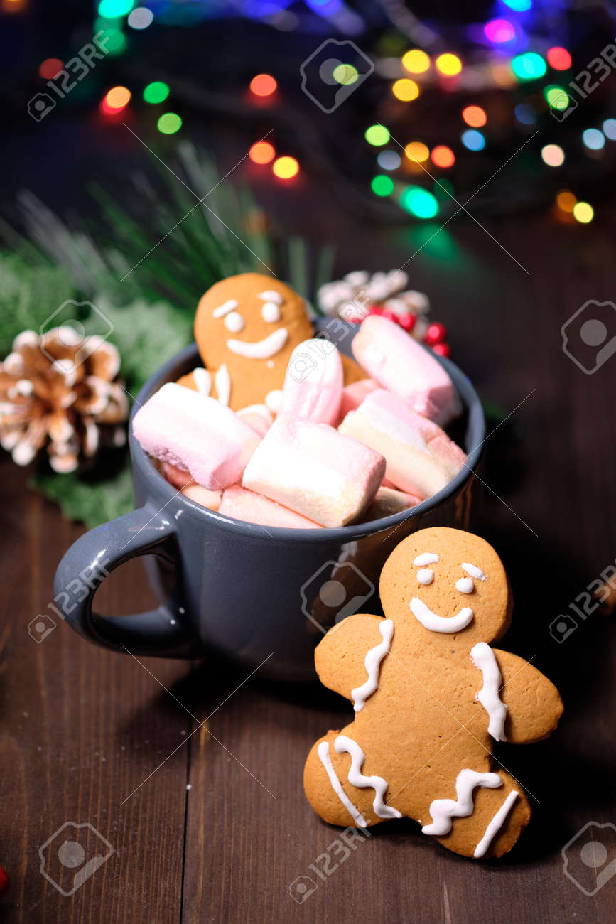 Almond Cookies And Marshmallow On Brown Background With Christmas