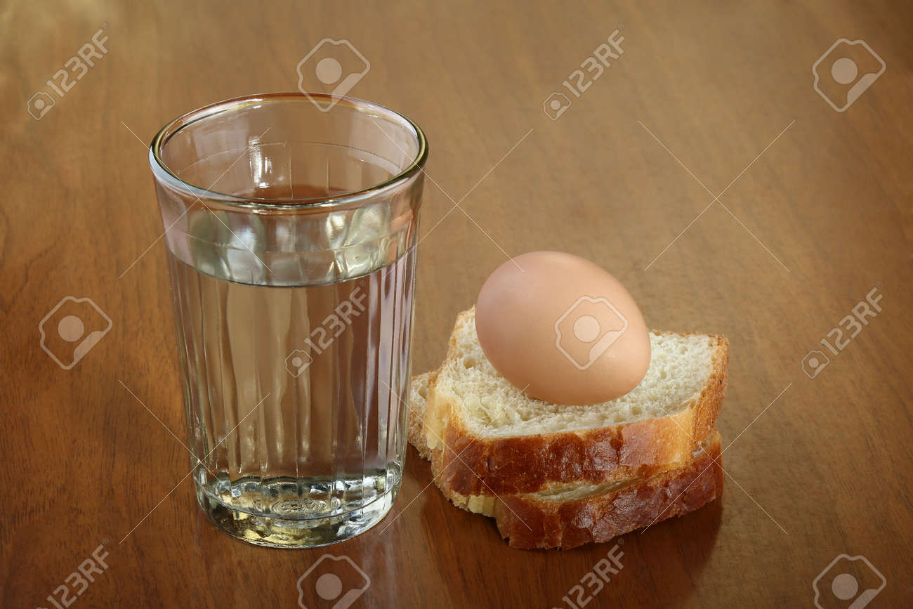 A Full Glass Of Water Egg And Two Slices Of Bread On Scratched Stock Photo Picture And Royalty Free Image Image 95446450