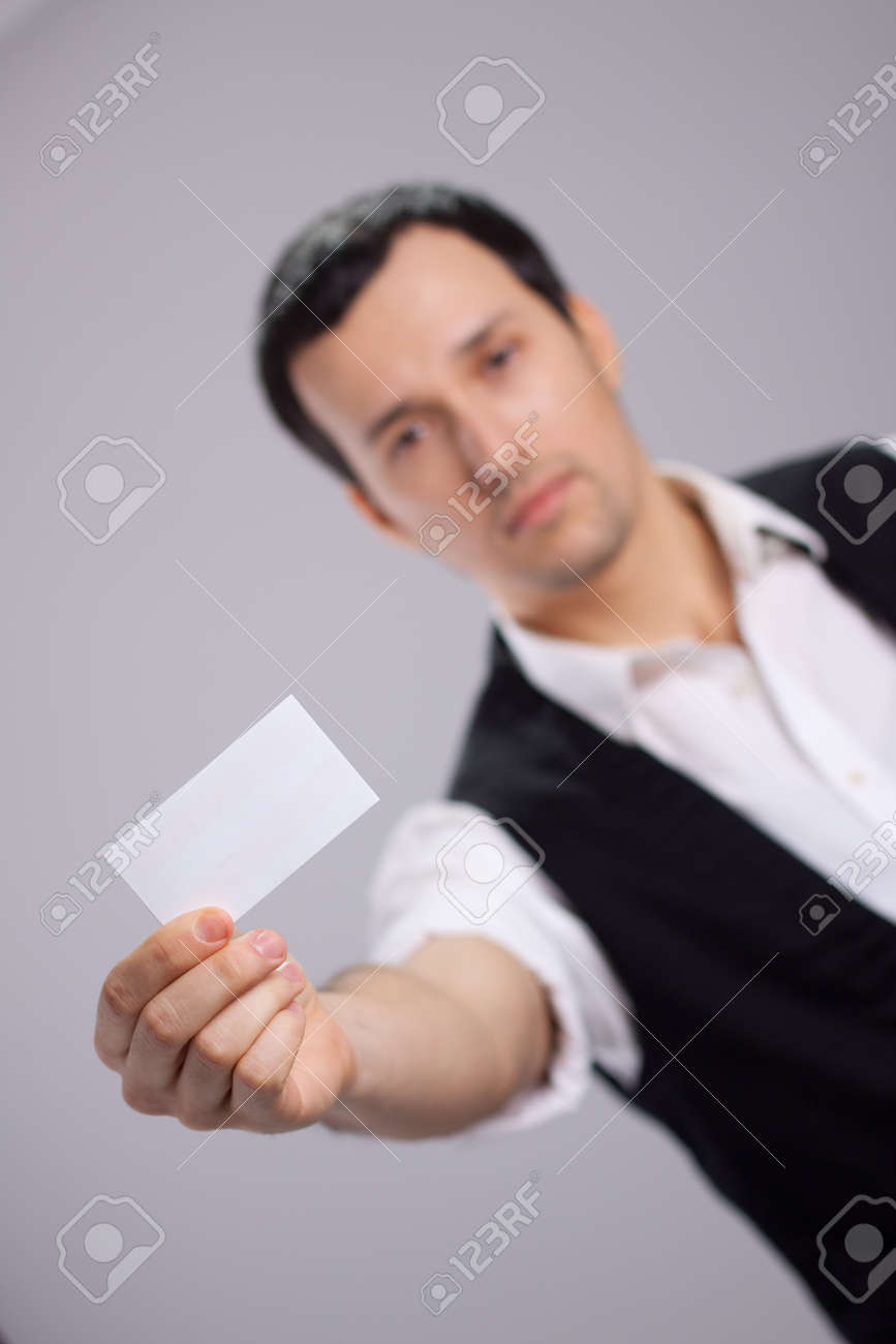 Young Guy With A Business Card In His Hand Stock Photo, Picture And ...