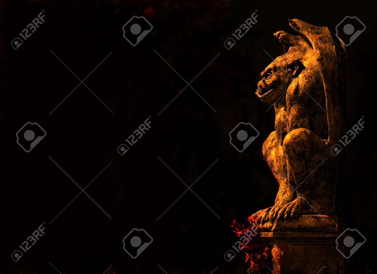 Gargoyle isolated on black background - 21431136