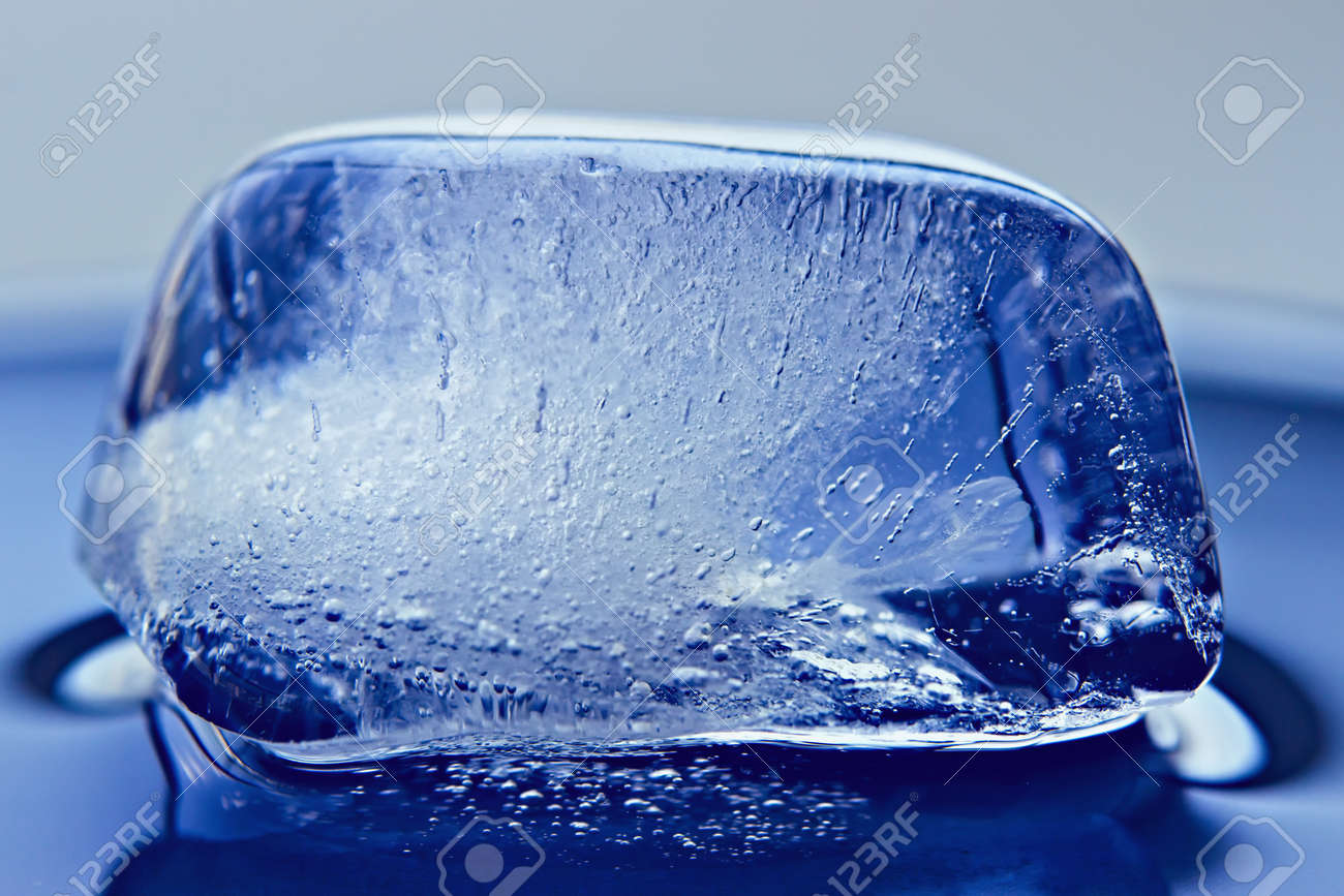 The Frozen Air Bubbles In Ice Cube Background Stock Photo