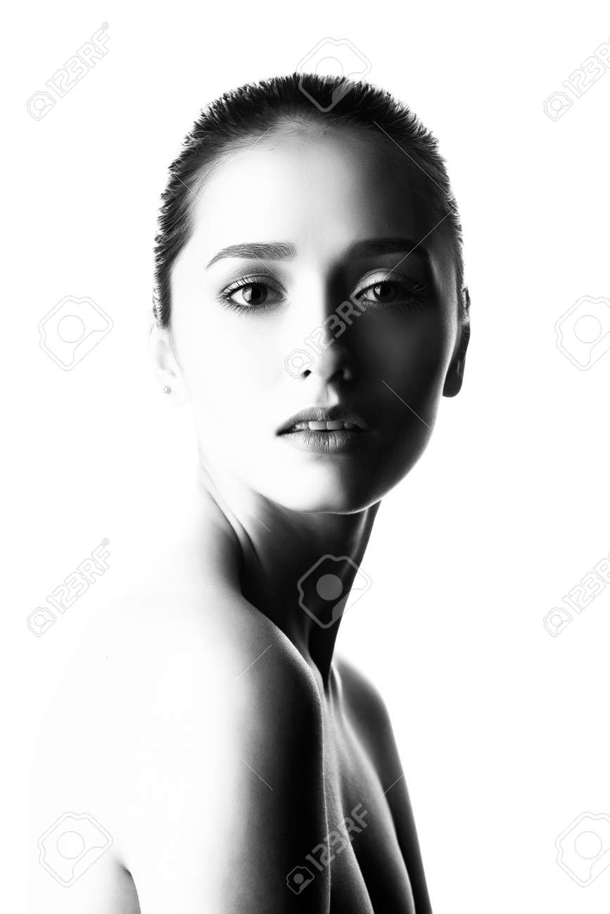 Close up portrait of a brunette girl with nude make up and naked