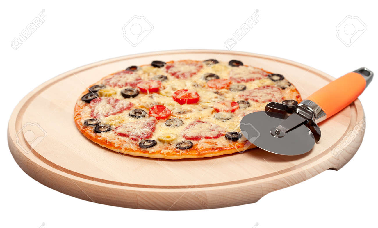 cook pizza on a cutting board with a round knife and spatula  isolated Stock Photo - 16581462