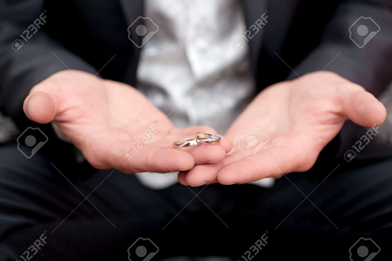 Gold Wedding Rings On A Hand Of The Groom Stock Photo, Picture And ...