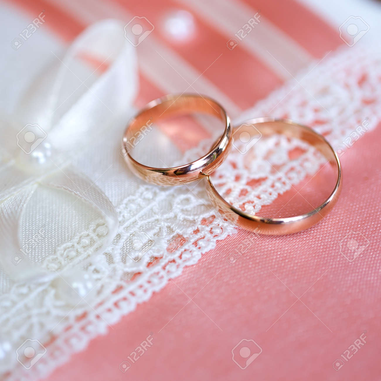 Wedding Gold Rings Bride And Groom On Decorative Pillow. Stock Photo ...