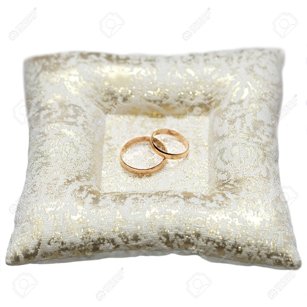 Wedding Gold Rings Bride And Groom On Decorative Pillow Isolated