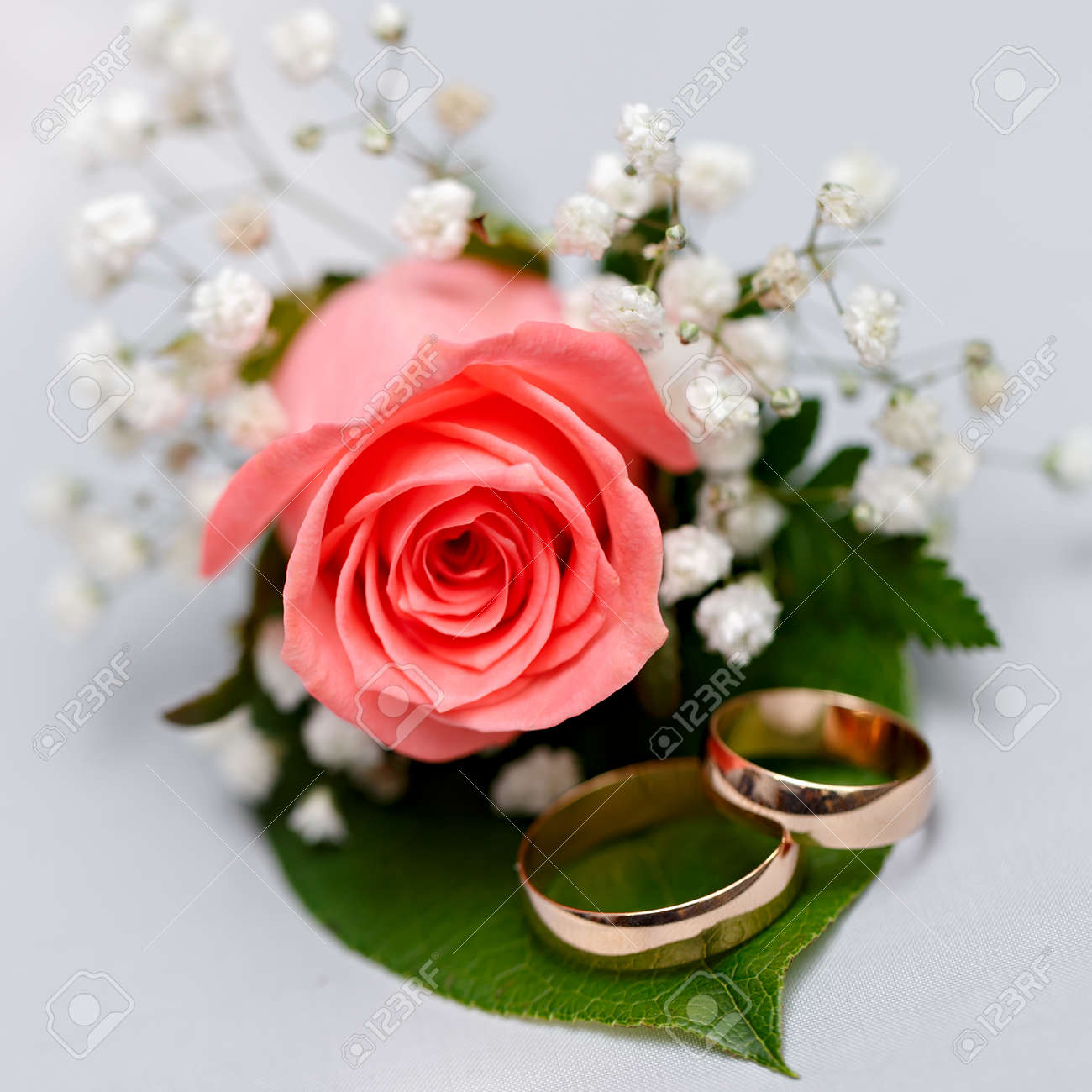 Gold Wedding Rings On A Bouquet Of Flowers For The Bride Stock Photo ...