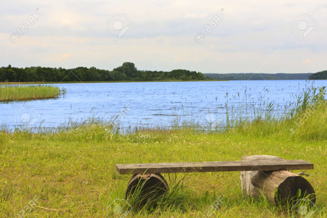 Wooden bench on the shore of beautiful Lake in Braslav Stock Photo - 14627138