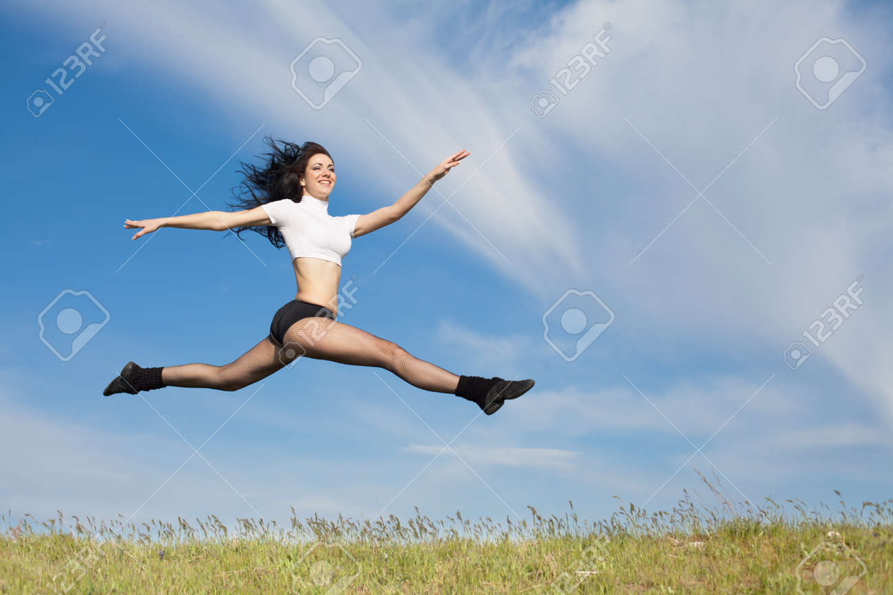Attractive young woman jumping on open air  Brunette jumps on background of sky Stock Photo - 13348304