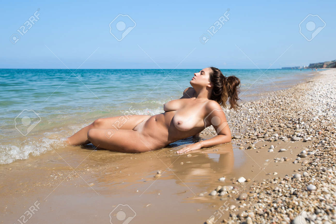 Female Person Resting On Pebble Sandy Beach Naked Young