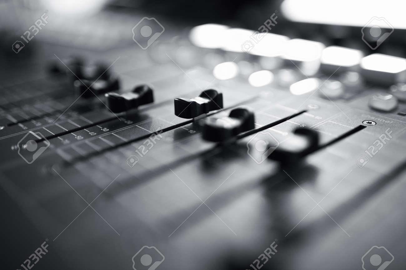 Professional Audio Mixing Console With Faders And Adjusting KnobsTV Equipment Black White Selective