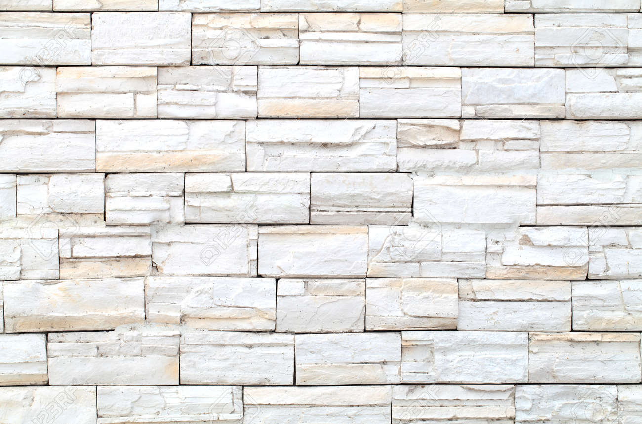 Pattern of White Modern stone Brick Wall Surfaced Stock Photo - 23243287
