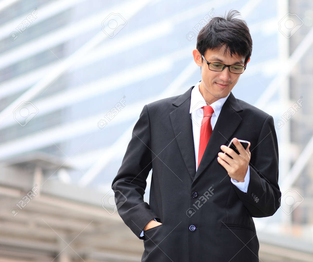 84e1a2107bb Man on smart phone - young business man. Casual urban professional  businessman using smartphone smiling