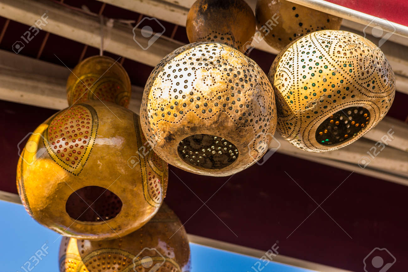 stock photo patterned decorative lamps made of dried pumpkins in a cafe in istanbul - Decorative Lamps