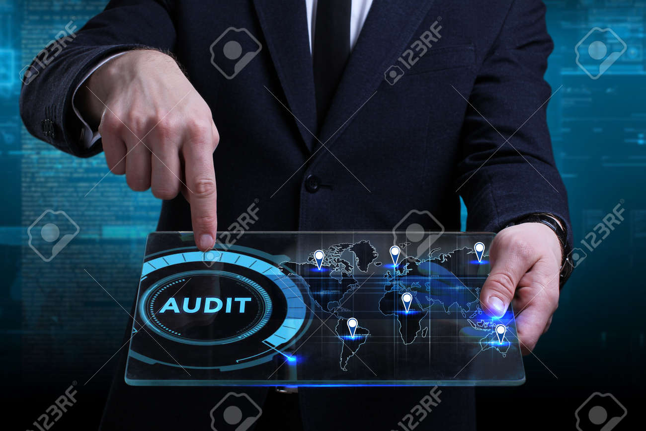 Business, Technology, Internet and network concept. Young businessman working on a virtual screen of the future and sees the inscription: Audit - 98645135