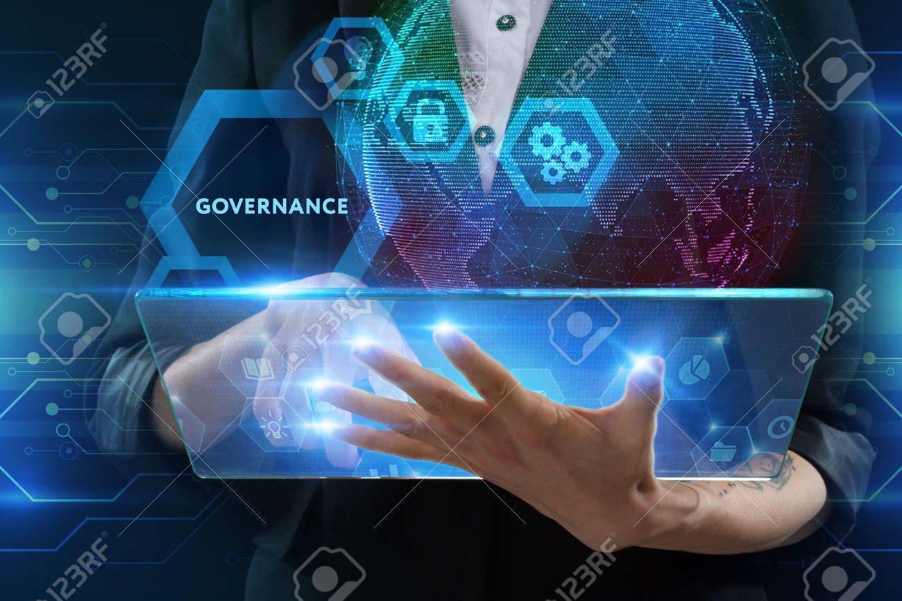 The concept of business, technology, the Internet and the network. A young entrepreneur working on a virtual screen of the future and sees the inscription: Governance - 121870378