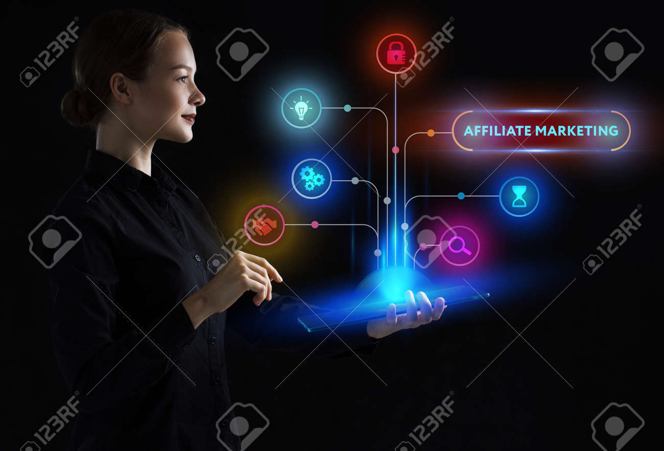 The concept of business, technology, the Internet and the network. A young entrepreneur working on a virtual screen of the future and sees the inscription: Affiliate marketing - 124387811