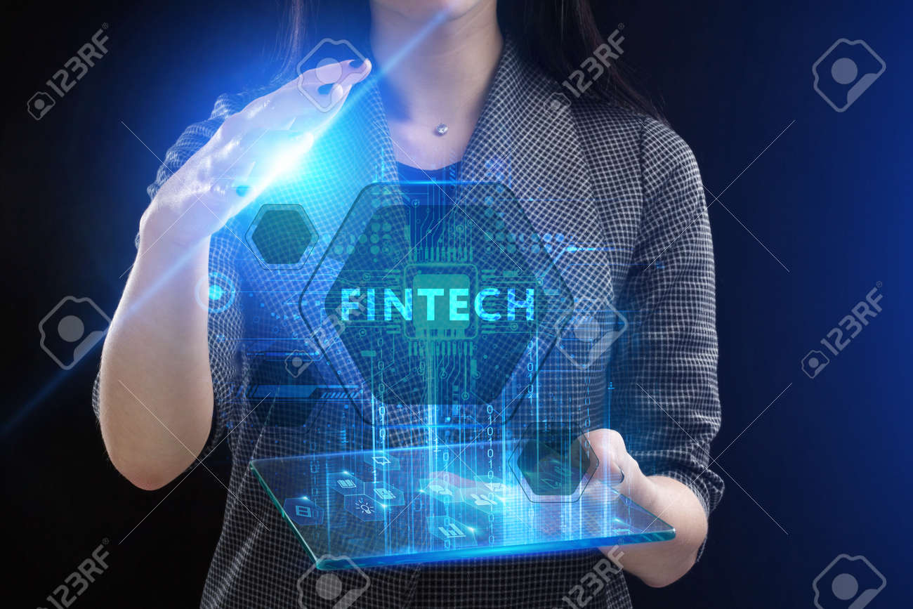 The concept of business, technology, the Internet and the network. A young entrepreneur working on a virtual screen of the future and sees the inscription: Fintech - 129366549