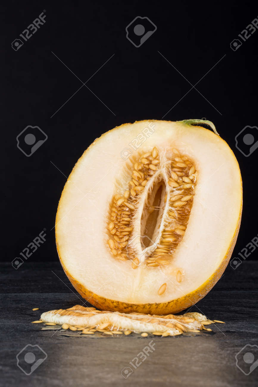 A Bright Cantaloupe Sliced In Half On A Black Stone Background Stock Photo Picture And Royalty Free Image Image 83314815 Nutrients, health benefits, and foodborne illness. 123rf com