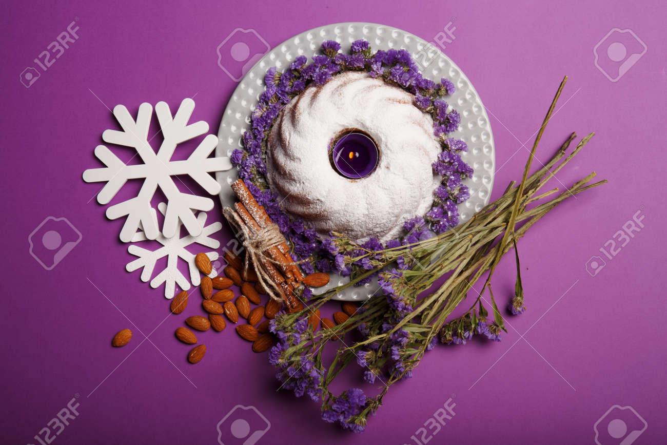 Top View Of White Snowflakes, Almond, Sticks Of Cinnamon, A Bouquet ...