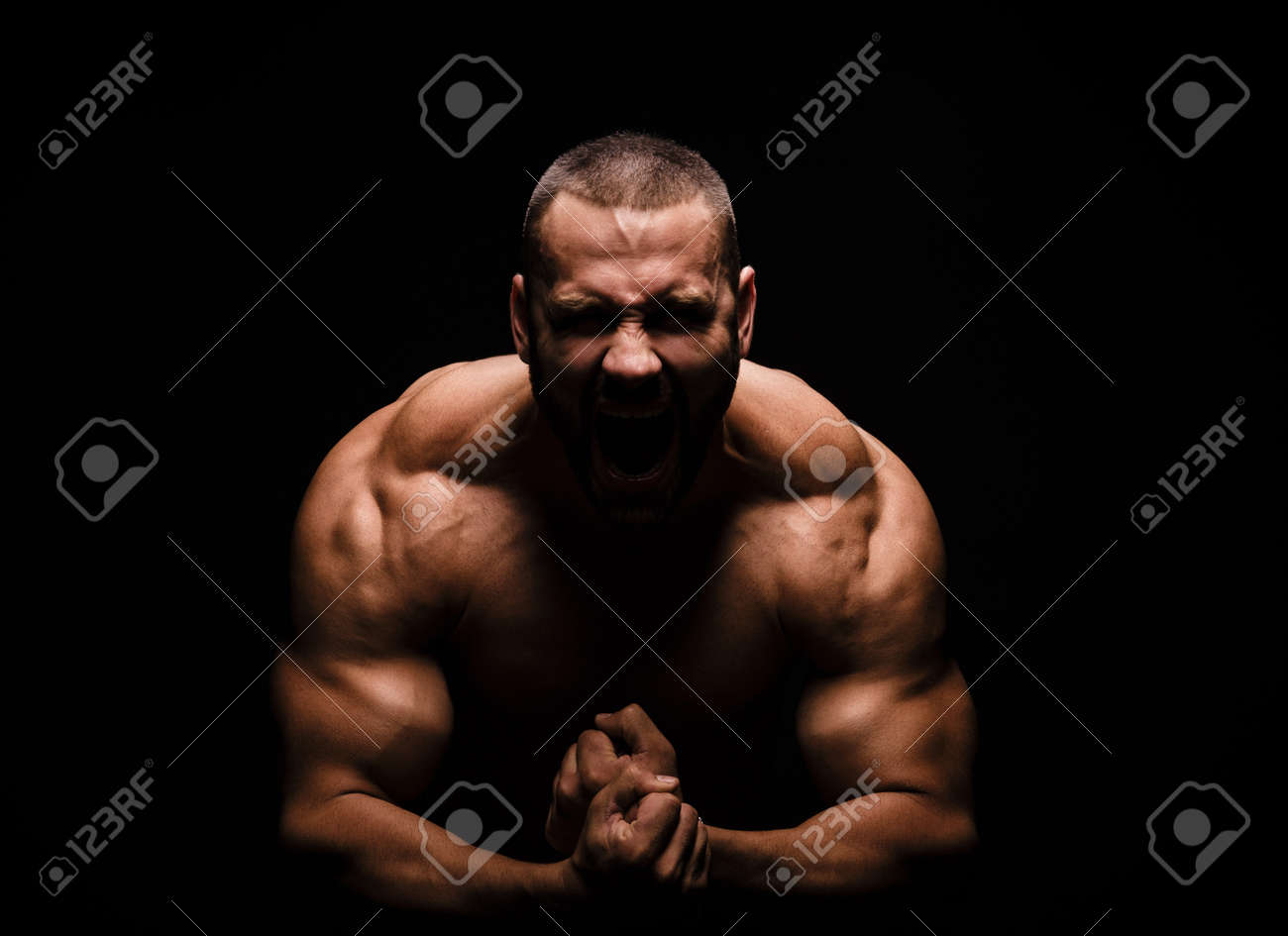 Close Up Of A Happy Fitness Model Man With A Muscular Body On